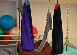 Colorful fabric swings used for physical therapy.