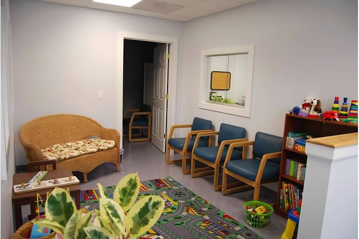 OT in Motion waiting room showing chairs and children's toys.