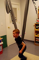 Child engaging in deep pressure exercise.
