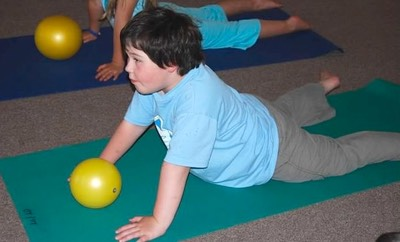 Boy doing arm and shoulder strengthening exercise