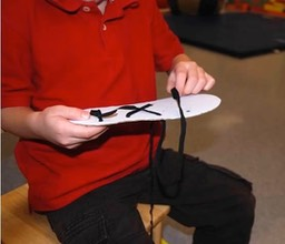 "Child engaging in a ""crossing midline"" exercise."