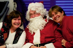 OT in Motion owners Jan Halley and Janet Correia with Santa Claus.