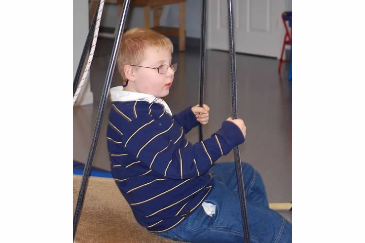 Child engaging in vestibular activity exercise.